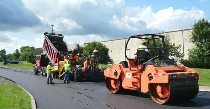 dump truck and roller